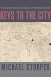 Keys to the city: how economics, institutions, social interactions, and politics shape development